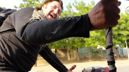 Andy Norris hitches a ride on a tuk-tuk in Sudan on his trans-African quest to r
