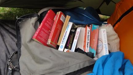 Steve's backpack bursting with books