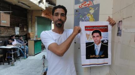 Sam with a picture of his brother Abel, who was shot by a sniper in Tahrir Squar