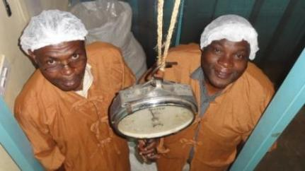 Angello (left) and James in the Fruits of the Nile dried fruit company Uganda