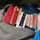Steve's backpack bursting with books