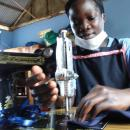 Her tailoring skills help herself and her fellow Ugandan women